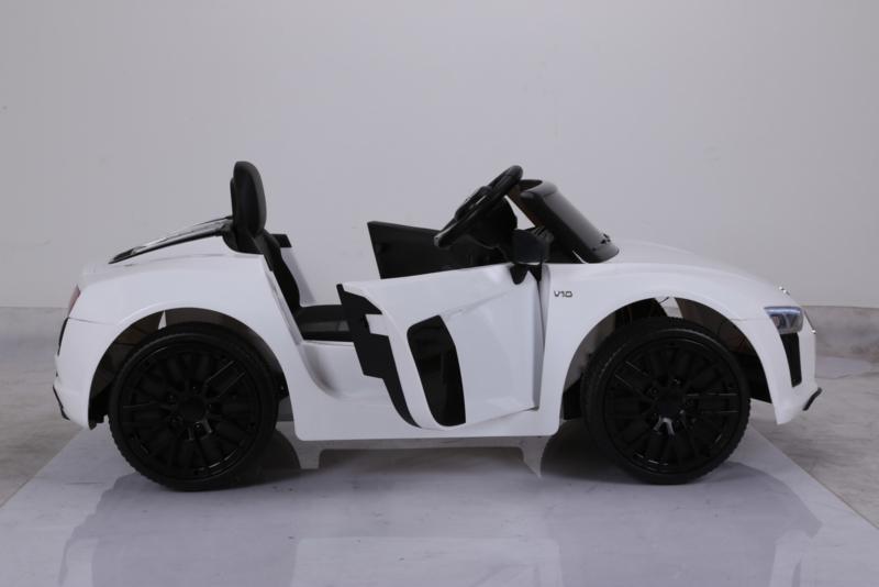 Coche eléctrico infantil Audi R8 Spyder Blanco con asiento acolchado en polipiel