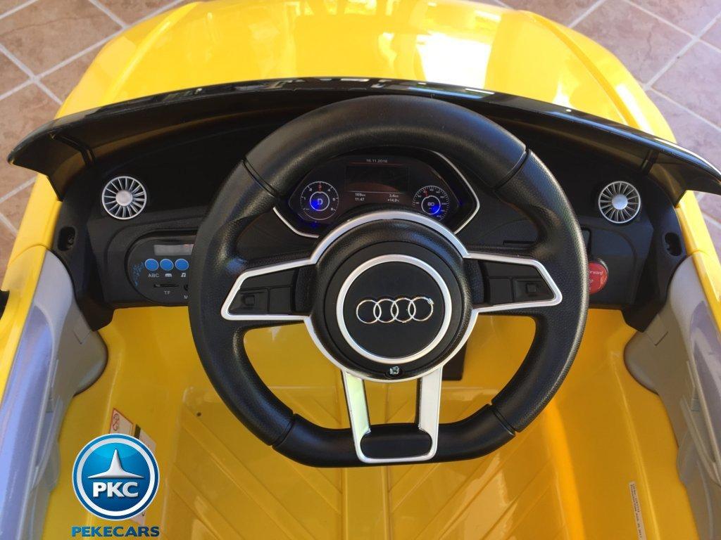 Coche electrico para niños Audi TT Amarillo volante con claxon y musica