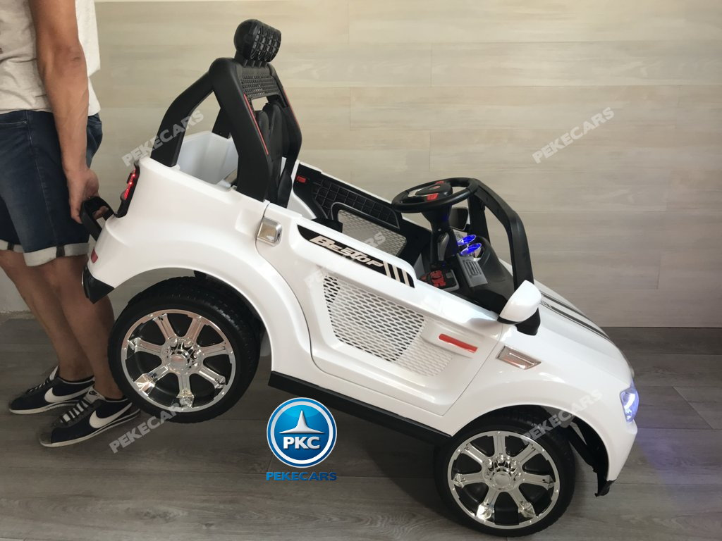 Coche electrico infantil BMW X7 Style 12V Blanco con asa de transporte