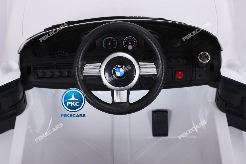 Coche eléctrico infantil BMW Z8 12V Blanco volante con claxon y musica
