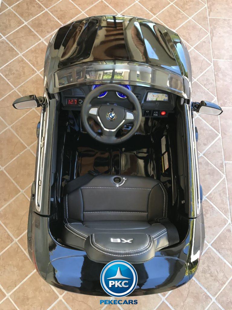 Coche electrico infantil BMW X6 Negro Metalizado interior