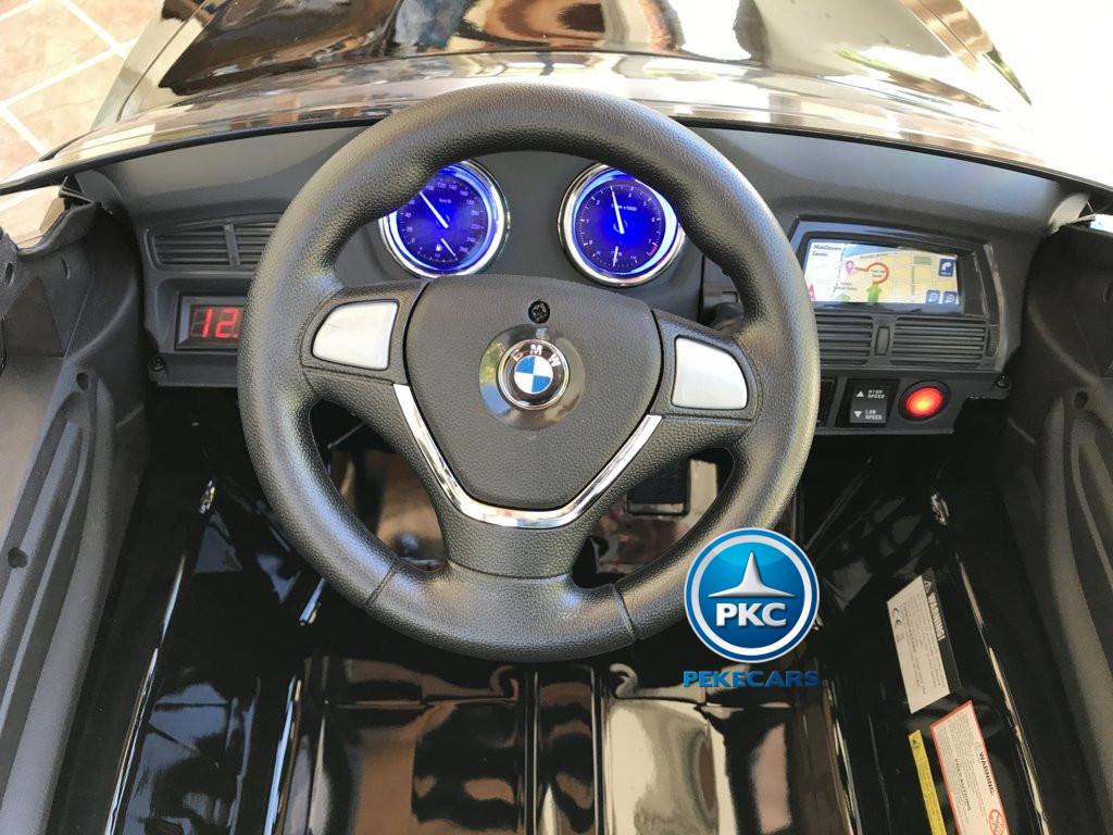 Coche electrico para niños BMW X6 Negro Metalizado volante con sonidos