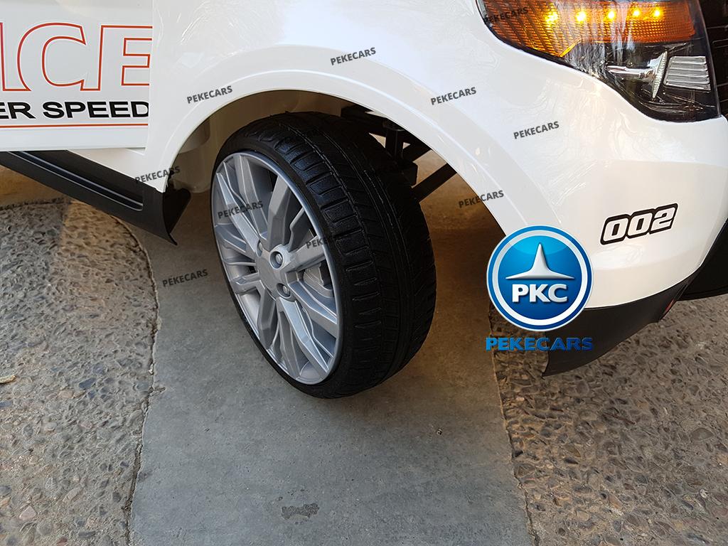 Coche electrico de policia para niños Blanco con ruedas de caucho antipinchazos