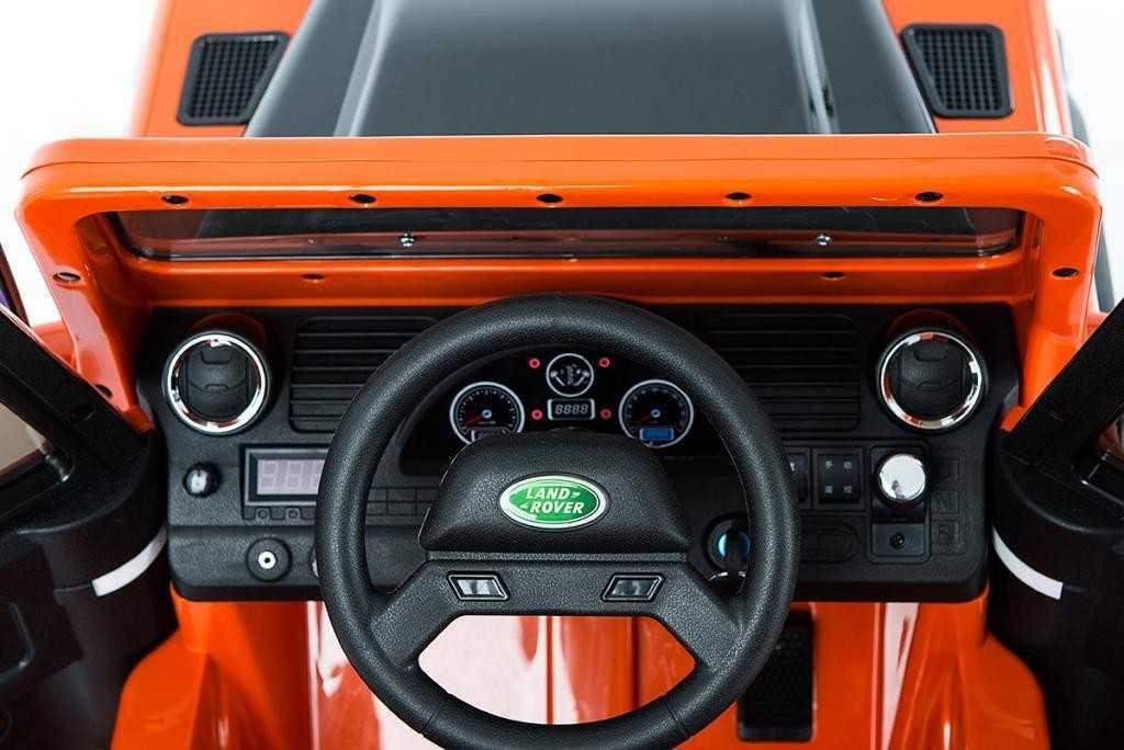 Todoterreno electrico para niños Land Rover Defender Naranja volante