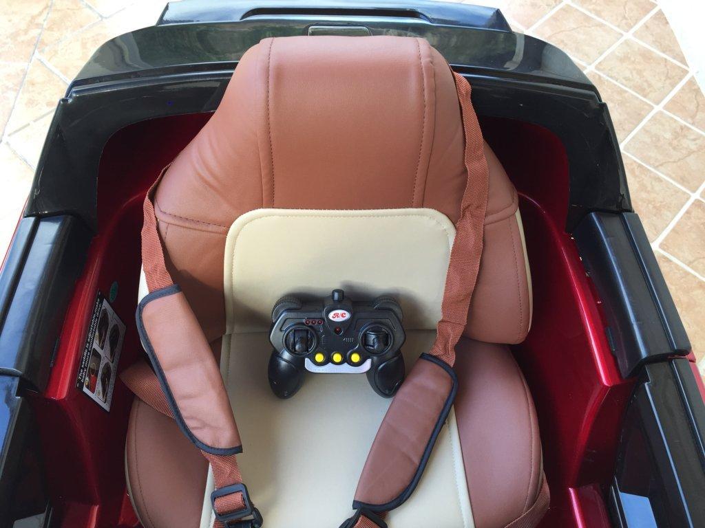 Coche electrico infantil evoque style rojo metalizado asiento acolchado en piel con cinturon de seguridad