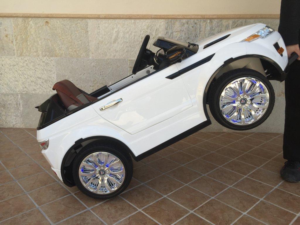 Coche electrico para niños evoque style blanco con asa de transporte