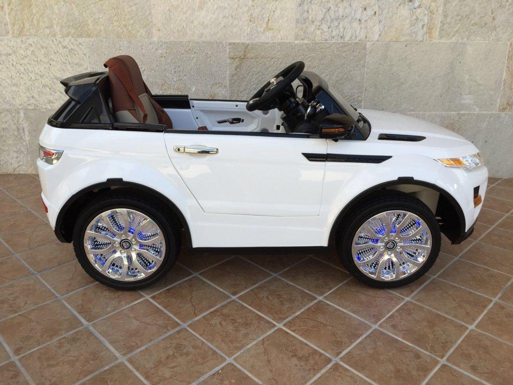 Coche electrico infantil evoque style blanco con luces en las ruedas