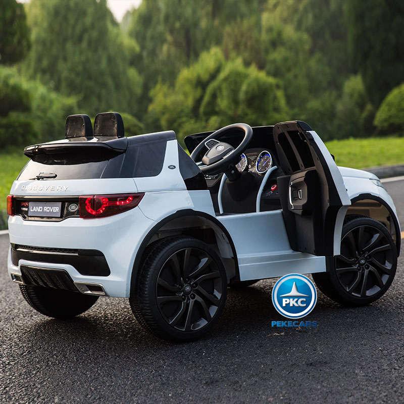 Coche eléctrico para niños Land Rover Discovery 12V MP4 blanco con apertura de puertas