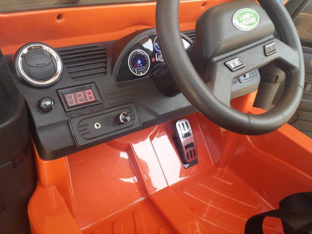 Todoterreno electrico infantil Land Rover Defender Naranja salpicadero