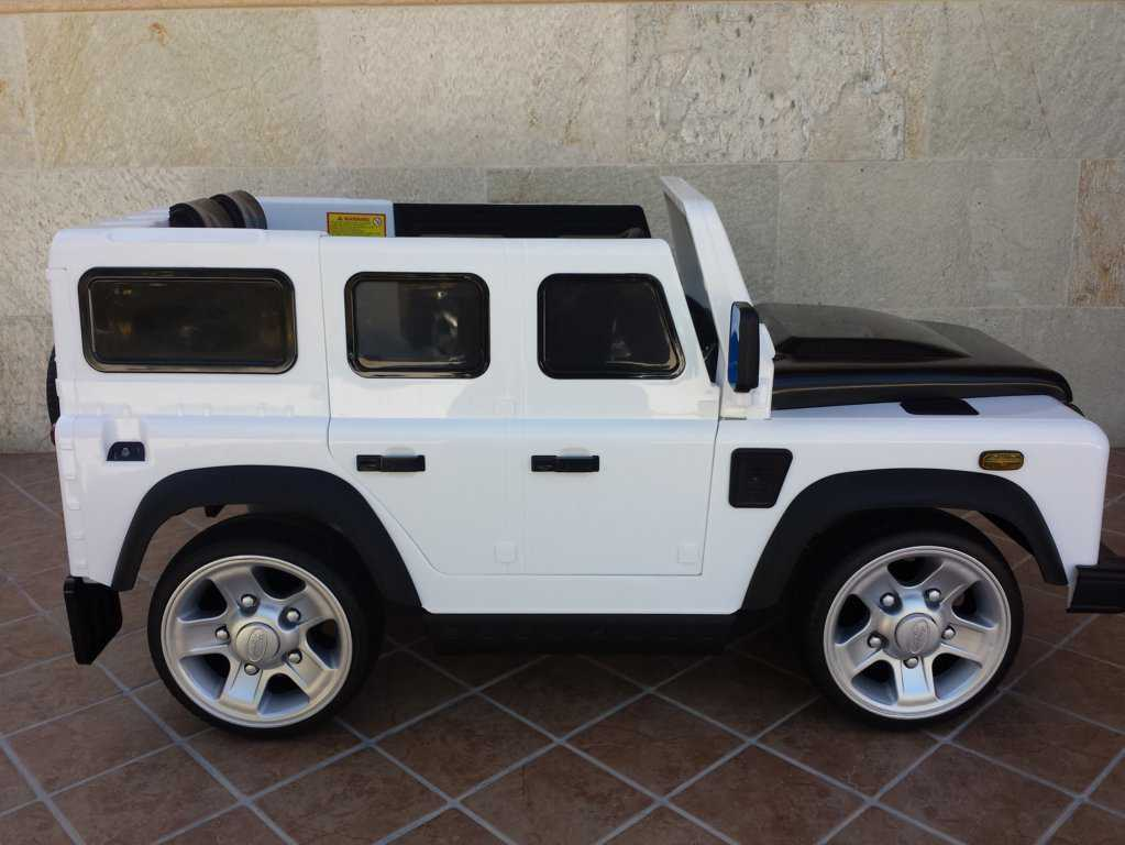 Todoterreno electrico infantil Land Rover Defender Blanco visto de lado