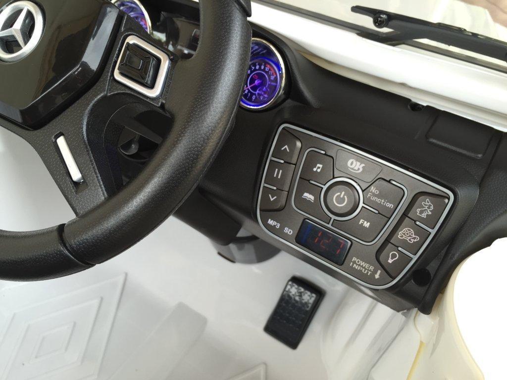 Todoterreno electrico para niños Mercedes G63 Blanco nuevo dashboard