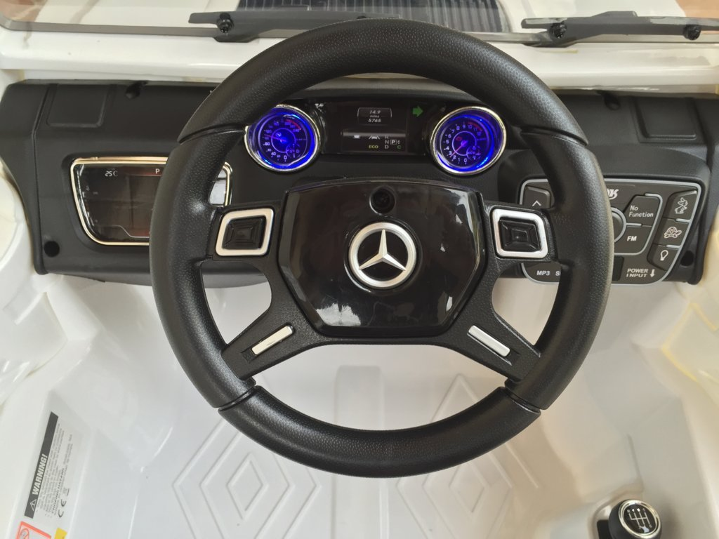 Todoterreno electrico para niños Mercedes G63 Blanco volante