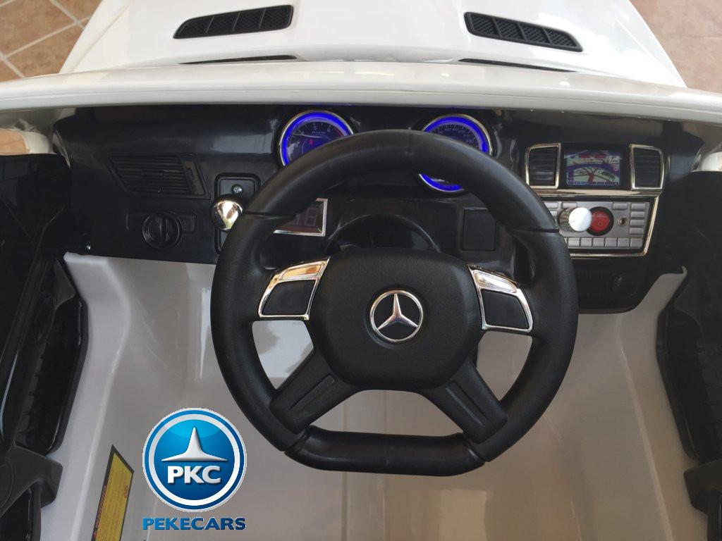 Coche electrico para niños Mercedes GL63 Blanco volante con musica y claxon