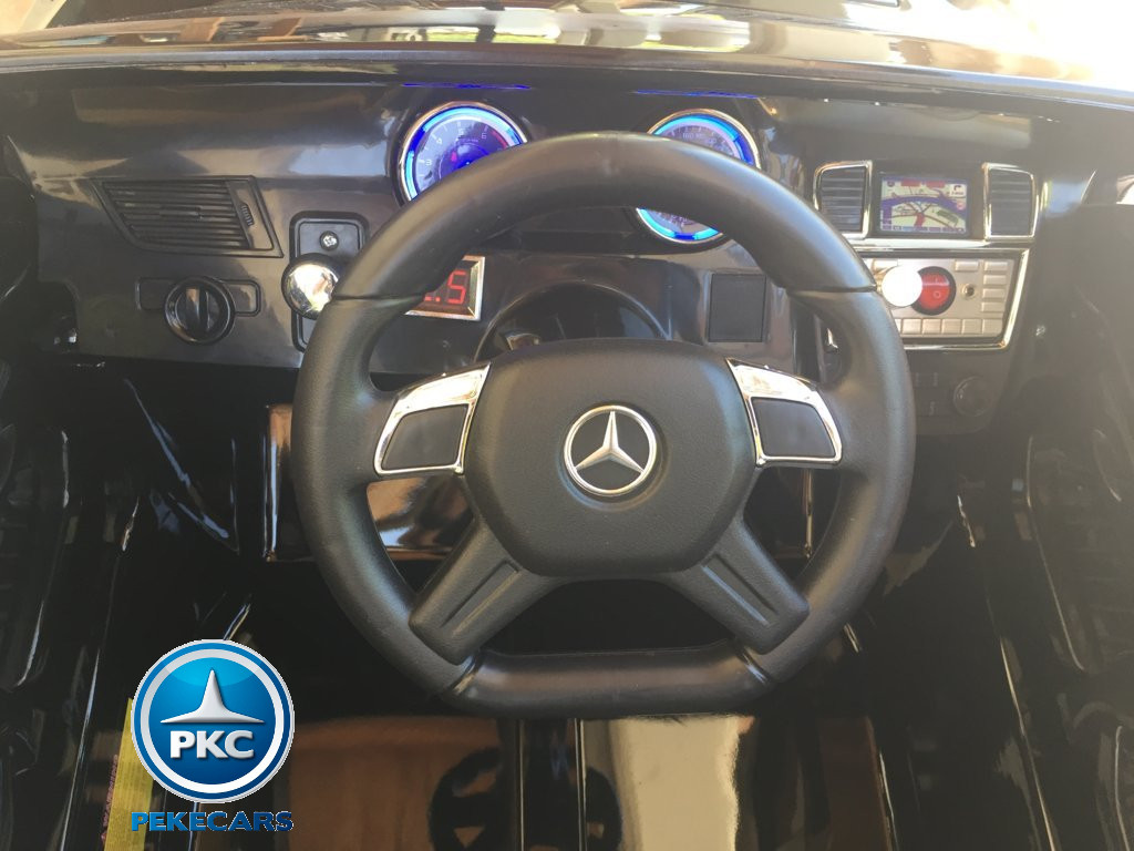 Coche electrico infantil Mercedes GL63 Negro Metalizado volante con musica y claxon