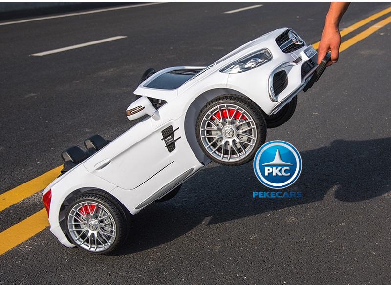 Coche electrico para niños Mercedes SL65 con MP4 y bateria extra Blanco con asa de transporte