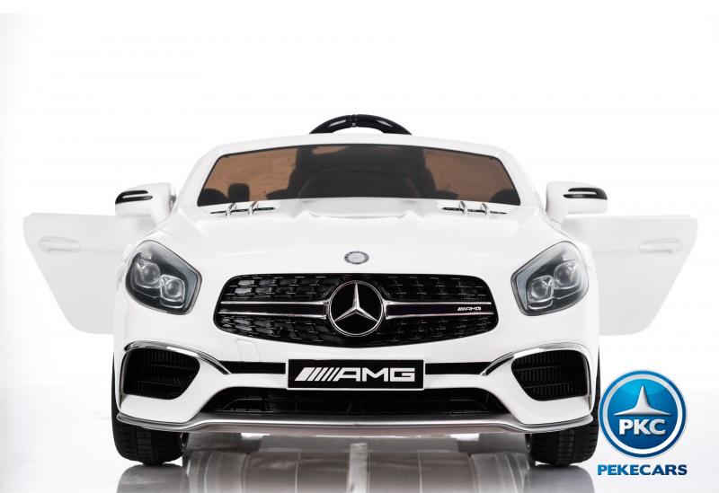 Coche electrico para niños Mercedes SL65 con MP4 y bateria extra Blanco luces LED frontales