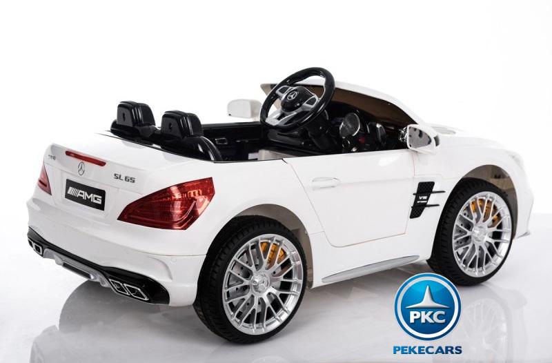 Coche electrico infantil Mercedes SL65 con MP4 y bateria extra Blanco bateria en el maletero