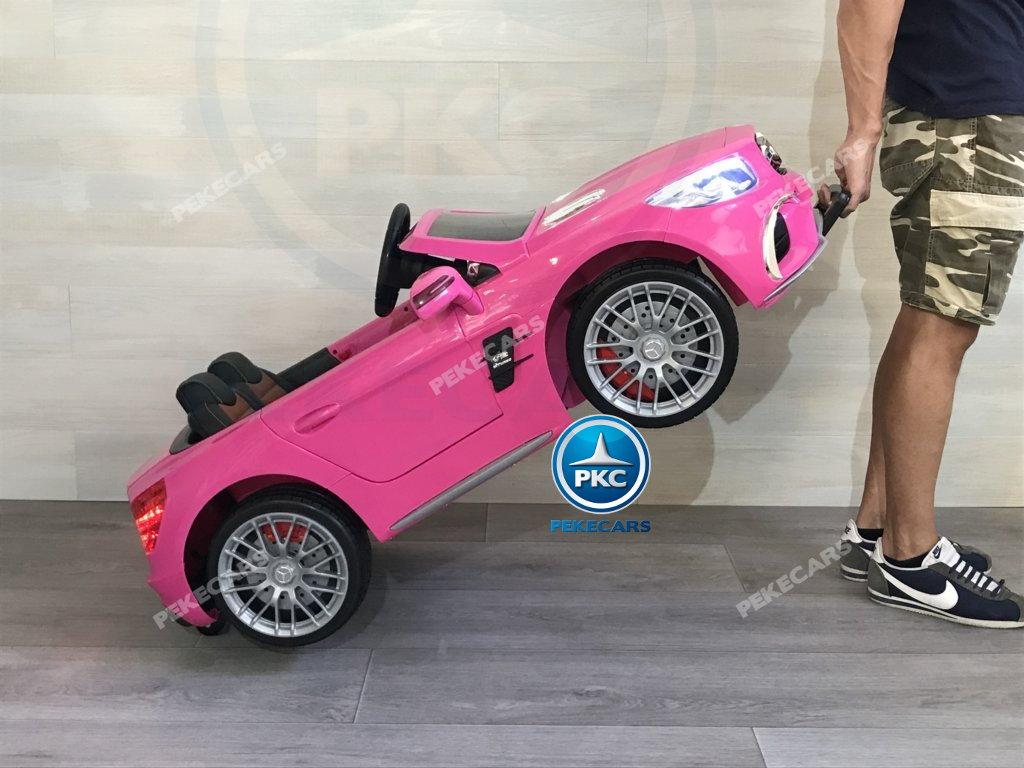 Coche electrico infantil Mercedes SL65 con MP4 y bateria extra Rosa asa de transporte