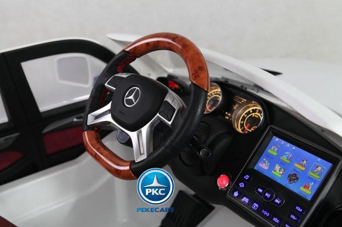 Coche electrico infantil Mercedes GL63 Version Superior Blanco volante ajustable