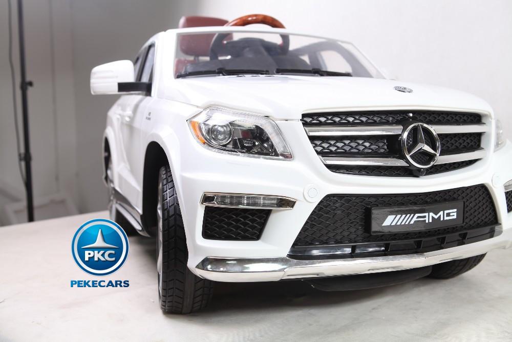 Coche electrico para niños Mercedes GL63 Version Superior Blanco con asa de transporte