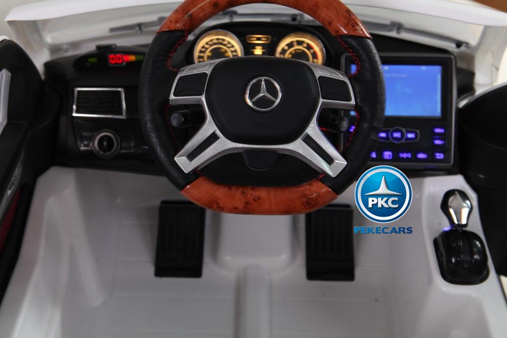 Coche electrico para niños Mercedes GL63 Version Superior Blanco volante en madera