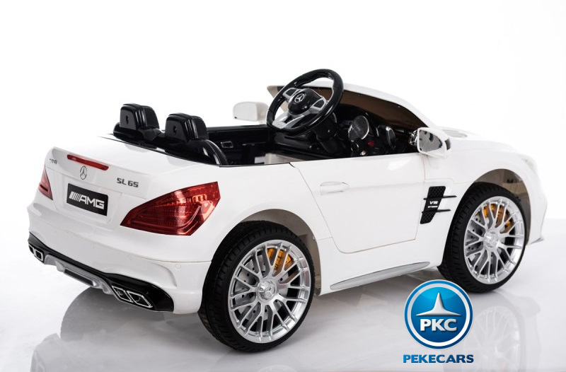 Coche electrico infantil Mercedes SL65 Blanco volante con musica y claxon
