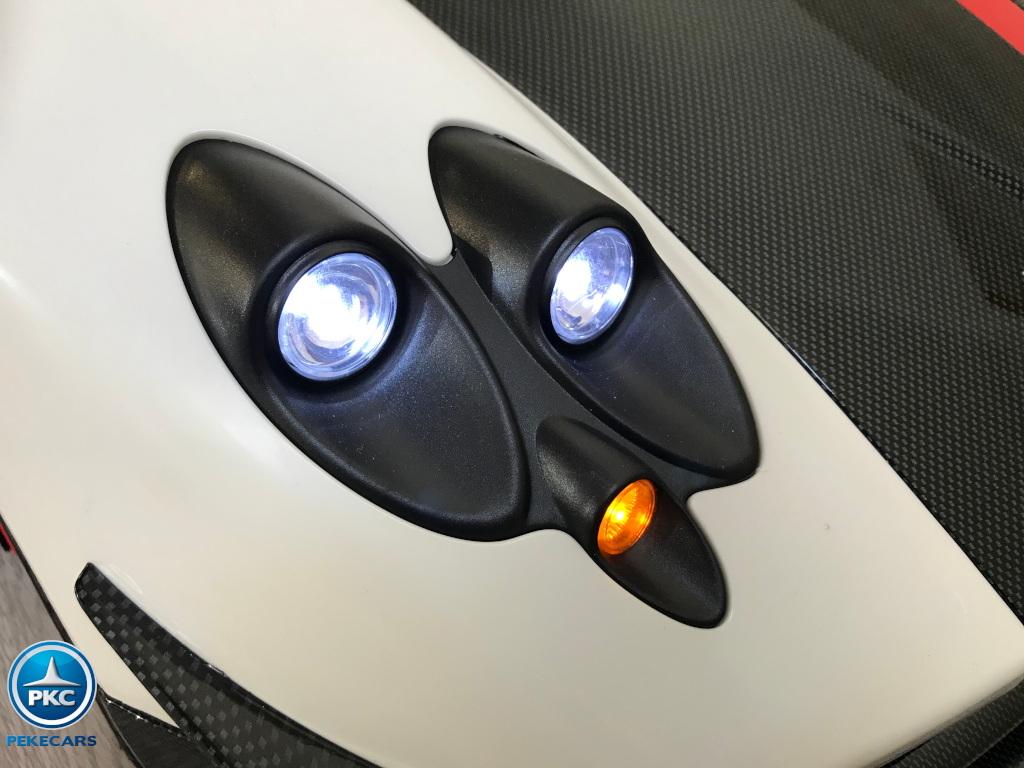 Coche electrico infantil Pagani Zonda Blanco luces delanteras