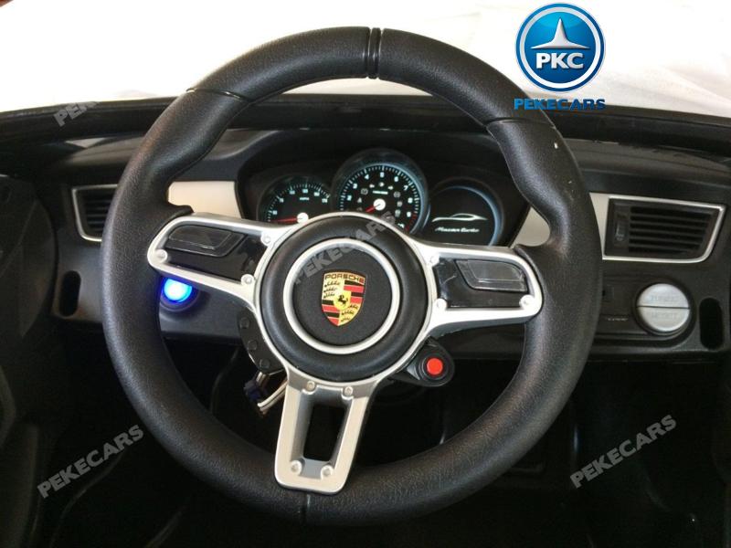 Coche electrico para niños Porsche Macan Negro volante con musica y claxon