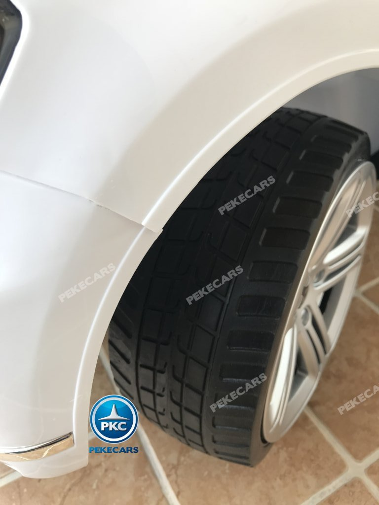 Coche electrico infantil Volkswagen Touareg Blanco con MP4 ruedas de caucho antipinchazos