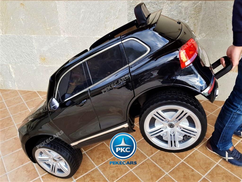 Coche electrico infantil Volkswagen Touareg MP4 Negro asa de transporte