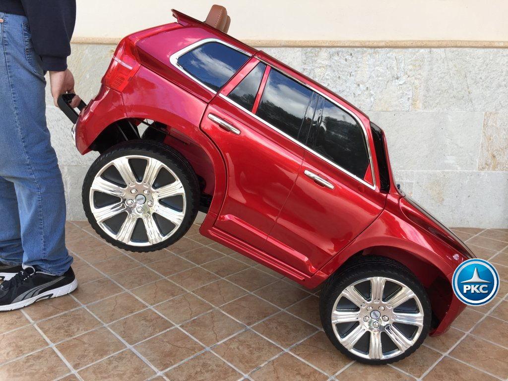 Coche electrico para niños Volvo XC90 Rojo Metalizado con asa de transporte